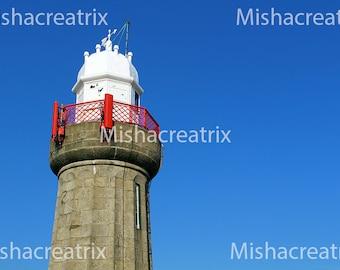 Lighthouse against a deep blue sky