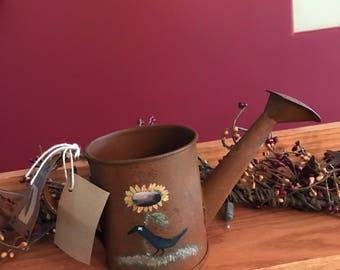 Two mini rusty tin watering cans