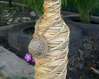 The wine bottle is braided with straw.A gift for a housewarming.Wine Bottle.Home decor.A gift for him.Straw.Rustic decor.