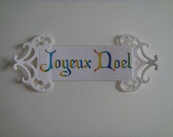 Cut multicolored white canson paper to create custom tag