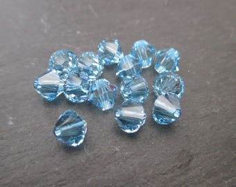Aquamarine 6 mm: 4 Swarovski Crystal bicone beads