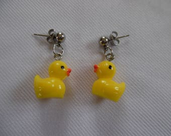 Earrings, duck yellow mounted on stainless steel stud.