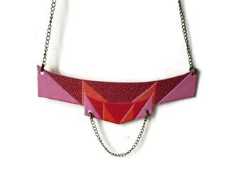 Retro inspired printed genuine leather bib necklace in trompe l'oeil red, pink, orange