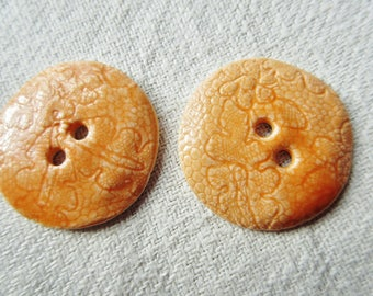 orange shiny porcelain set of 2 buttons