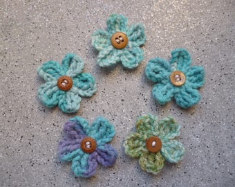 5 flowers crocheted turquoise blue cotton decorated with a Brown button