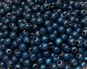 100 Navy blue magic beads