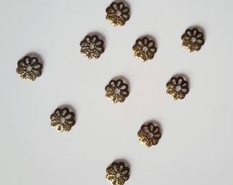 Openwork bronze metal caps