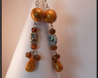 Earrings fimo gold beads and glass beads.