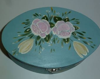wooden box in blue, featuring pink and yellow flowers.