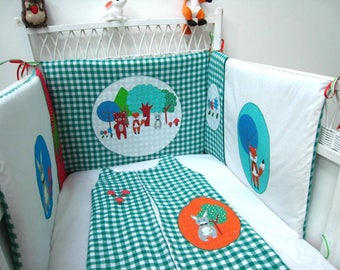 Bumper green and white themed baby forest animals