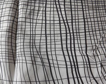 FABRIC PATTERN LINES ON WHITE BACKGROUND BLACK SILK
