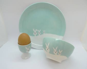 Birth set ,porcelain dishes,playfull bunnies in the snow