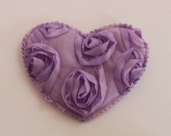 very pretty purple heart with flowers in relief