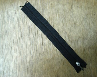 thin black plastic zipper