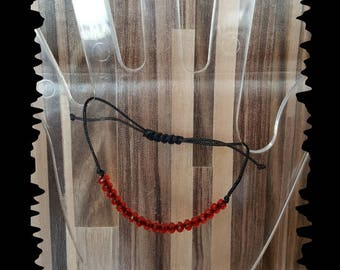 Cord bracelet and Red faceted beads