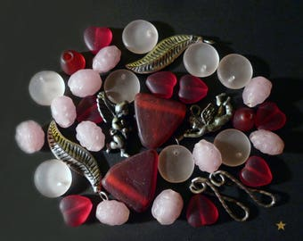 34 red, pink Indian glass beads frosted and silver metal charms