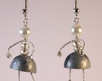 Earrings with gunmetal grey skirt doll.