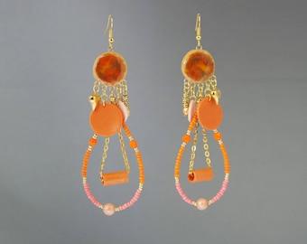 Long orange earrings in polymer clay