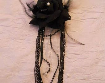 Black flower clip, beads and lace and feathers