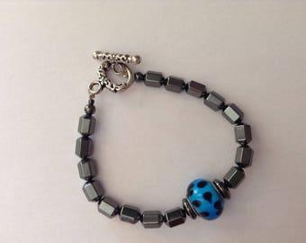 Central blue glass and hematite Bead Bracelet