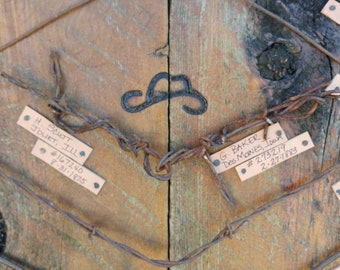"""10 pieces of 18"""" collectible barb wire on a display barn wood from the 1800'"""