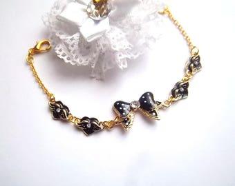 Bracelet with black enamel bow and 4 black enamel hearts