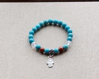turqoise blue tinged howlite charm bracelet
