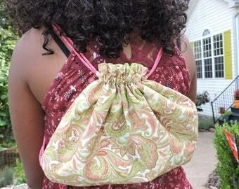 green and pink paisley drawstring sack