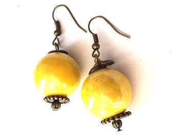 vintage earring with 22 mm canary yellow ceramic bead, brass hook