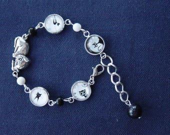 Silver cat in black and white metal bracelet