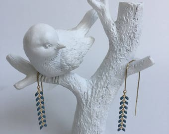 A chain and spikes enamelled Peacock earrings