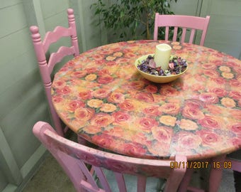 Pink dining table with decoupage roses and four chairs