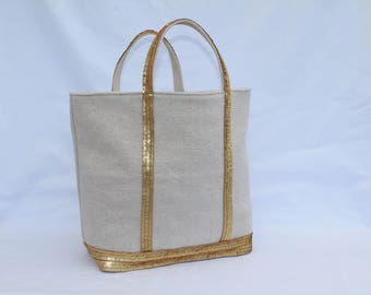 The bag in linen-cotton with sequins gold matte