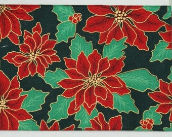 Christmas fabric coupon - poinsettias with a black background.