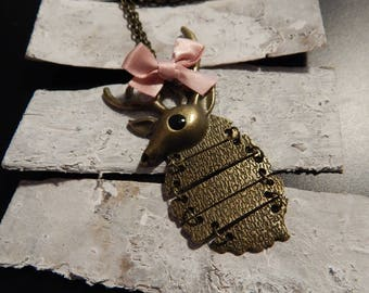Deer necklace in bronze and pink bow