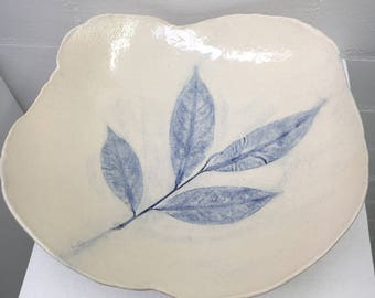 Rounded blue leaf bowl.