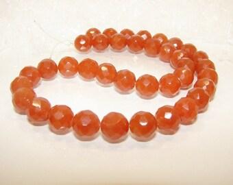 Orange aventurine faceted ball 10.00 mm. Semi precious stone.