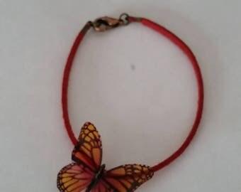 Bracelet suede red butterfly effect transprent yellow orange