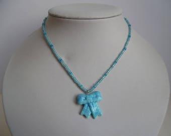 Necklace little girl knot pendant
