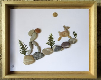 Hiker with his dog - Collage of pebbles-