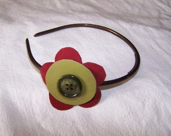 Headband decorated with a Burgundy and green leather flower