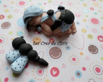 baby boy onesie made of polymer clay.