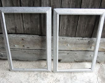 2 old stucco on wood frames