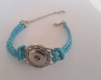 Turquoise braided synthetic leather strap is 18mm snap buttons