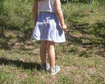 Girl in gingham cotton skirt