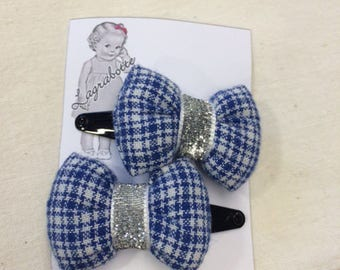 set of 2 hair clips set with a blue/white striped fabric bow