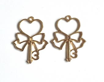 Set of 2 gold metal bow and heart key pendant