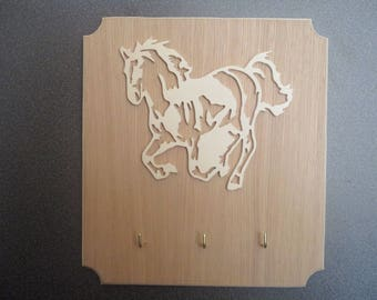hanging key with cut galloping horse