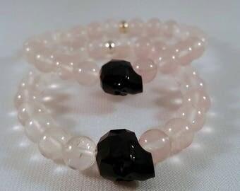 Precious gemstone bracelet made of rose quartz, Swarovski-crystal skull in black, Silver pearl, elastic band