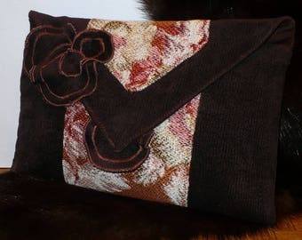 clutch bag decorated with faux suede flowers